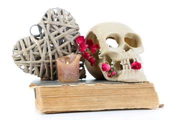 Skull, wicker heart and dried roses