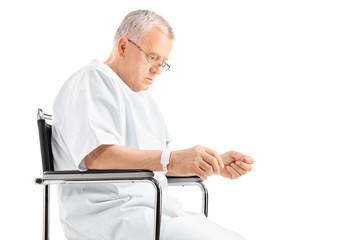 Sad mature man sitting in a wheelchair
