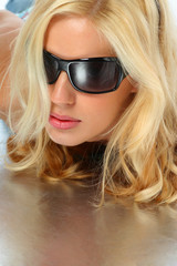 Attractive blonde girl with sunglasses