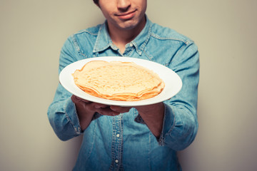 Man with stack of pancakes