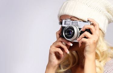 Photographer. Unrecognizable blonde young woman taking photo