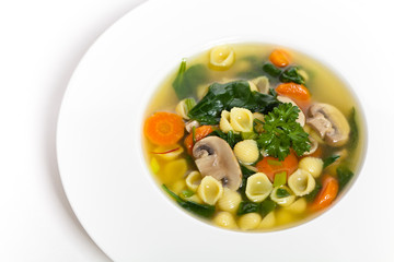 Vegetable soup with spinach and pasta