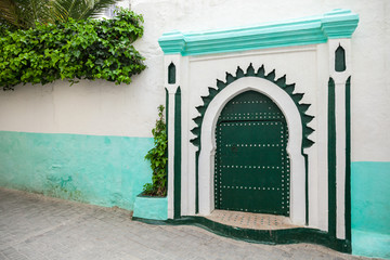 Wall Mural - Green wooden gate of ancient mosque in Medina. Tangier, Morocco