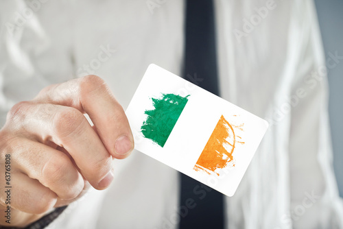 Irish businessman holding business card with ireland flag stock irish businessman holding business card with ireland flag reheart Gallery