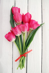 spring pink tulips on white board