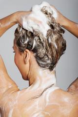 Photo sur Aluminium Akt Woman taking a shower