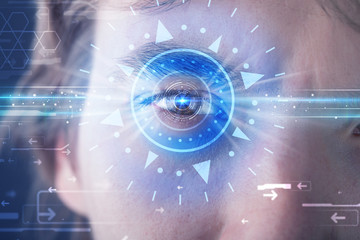 Wall Mural - Cyber man with technolgy eye looking into blue iris
