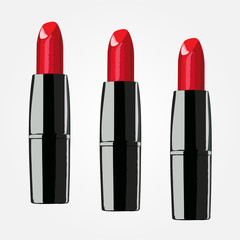 red lipsticks on the white background