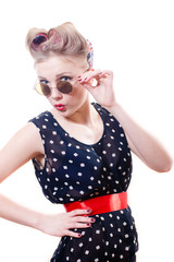 Rockabilly woman with curlers having fun in sunglasses