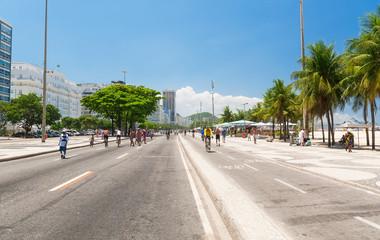 Copacabana with palms and mosaic of sidewalk in Rio de Janeiro