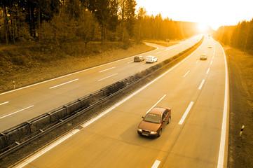 Fototapete - Sonnenuntergang auf der Autobahn