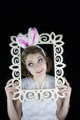 Woman with rabbit ears and frame