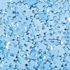 disassembled blue puzzle pieces closeup