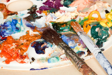 two paintbrush and strokes of oil paints