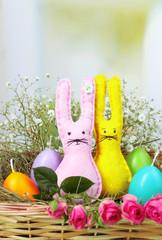 Funny handmade Easter rabbits in wicker basket