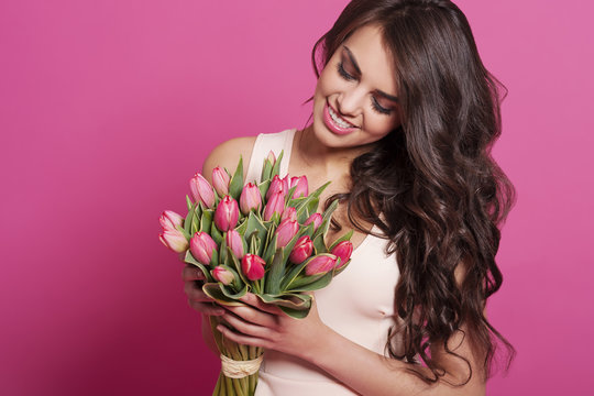 Lovely woman holding spring bouquet