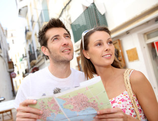 Couple of tourists visiting city street of Ibiza