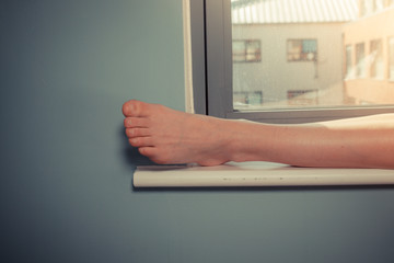 Woman's foot on window sill