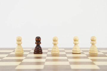 Chess pawn on chessboard