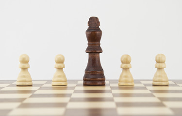 Chess king and pawns on chessboard