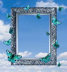 Butterflies in frame on blue sky