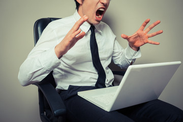 Businessman angry at laptop