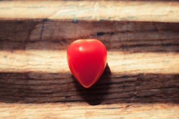 Unusual heartshaped tomato on wood table