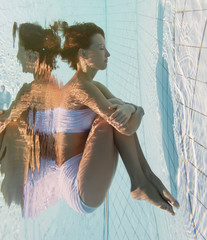 Beautiful girl is under water
