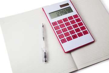 Calculator and pen on notebook