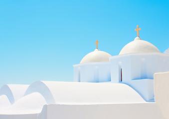 2 Beautiful old white twin churches in  Amorgos island in Greece