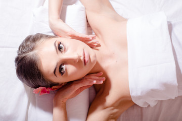 relaxed beautiful woman lying on her back