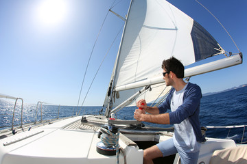 Foto op Aluminium Zeilen Man sailing with sails out on a sunny day
