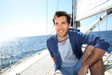 Smiling handsome man on sailboat