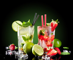 Mojito drinks on black background