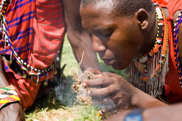 Masai making fire in Masai Mara National Park