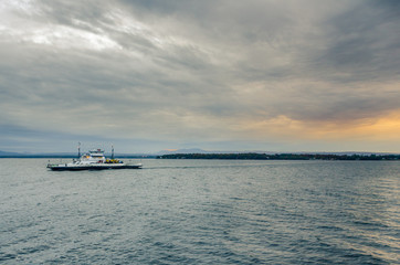 Ferry on a Lake and Cloudy Sky at Sunset