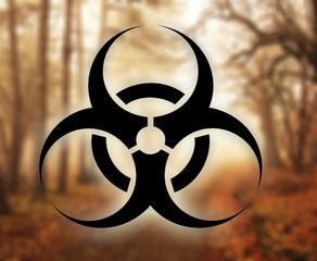 Biohazard symbol against nature background