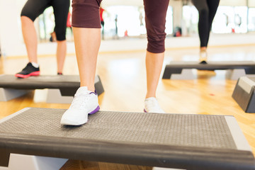 close up of women legs steping on step platform