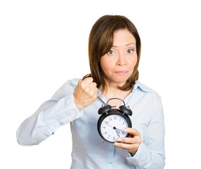Shut that clock up. Angry middle aged woman with alarm clock