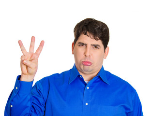 Third place loser. Man shows three fingers, white background