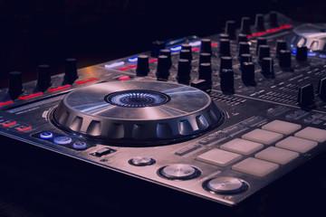 Dj mixer at a nightclub.