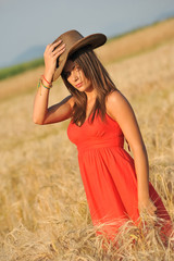 Portrait of young woman in yellow wheat field