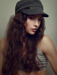 Trendy hiphop young woman in grey cap. Closeup vintage portrait