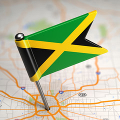 Jamaica Small Flag on a Map Background.