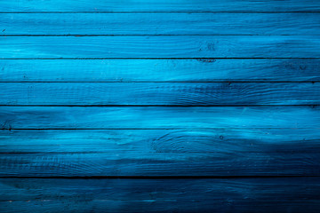 Colorful rich blue wooden background texture