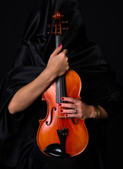 Female Violinist Holds Bow Across Musical Violin Acoustic
