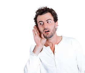 Portrait Curious man, hand to ear, listening to latest rumors