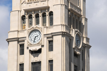 Clock on a Brown Tower