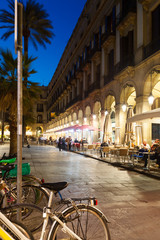 night view of Placa Reial with restaurants