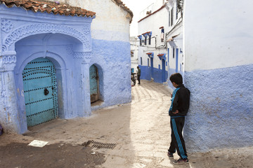 CHEFCHAOUEN, MOROCCO, NOVEMBER 20: kid staying on street of the